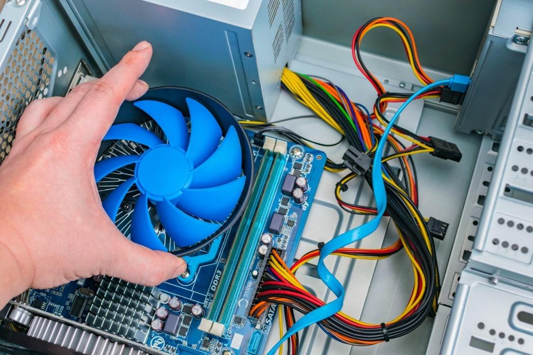 Computer repair - hand replacing processor fan